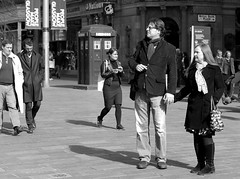 The Doctor's new companion (VelvetJones_) Tags: street blackandwhite bw scarf canon 50mm glasses couple who glasgow candid streetphotography together doctor buchanan tardis companion searching 70d