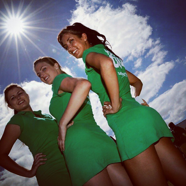 The promotion girls #track #girls #F1 #racing #sun #clouds #event #Australia #smiles #GrandPrix #filming #film #music #green #legs