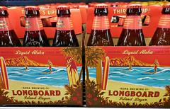 Longboard Lager (kenjet) Tags: red orange beer brewing hawaii store bottle bottles alcohol longboard kauai abc brew lager kapaa abcstore konabrewingcompany islandlager liquidaloha