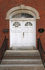 Doorway  London, OH (Pythaglio) Tags: county ohio house building brick london sign stone plaque mailbox early doors steps entrance double structure molding historic doorway madison bond keystone railing residence flemish federal entry capitals dwelling arched replaced fanlight fourpanel ca1830 segmentalarched