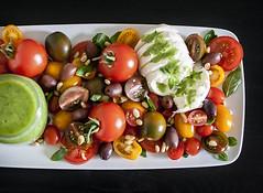 HEIRLOOM TOMATO CAPRESE SALAD (whimsandwhisks) Tags: food tomato tomatoes foodies foodporn basil mozzarella pinenuts caprese heirloomtomatoes whisks kalamataolives heirloomtomato whims whimsandwhisks basilpestodressing