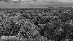 Erosion (andbog) Tags: badlands canon southdakota bigbadlandsoverlook usa states nature landscape panorama natura usnationalpark nationalpark 16x9 169 widescreen g12 powershot paesaggio sd canong12 unitedstatesofamerica badlandsnationalpark badlandsnp compactcamera pinnacles monochrome bn bw biancoenero blackandwhite cloudy overcast clouds nuvoloso nuvole geologicalformation cliff canyon overlook view erosion over100fav