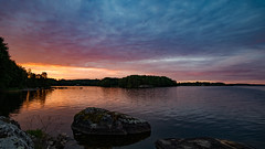 Sunrise Rgn (jarnasen) Tags: morning trees sky lake nature water sunrise landscape island dawn rocks colorful sweden outdoor tripod wide kayaking fujifilm sverige stergtland lakescape xm1 jrnlunden nordiclandscape samyang12mmf2 rgn