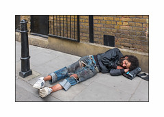Homeless Man, East London, England. (Joseph O'Malley64) Tags: homelessman homeless eastlondon eastend london thisislondon2016 england uk britain british greatbritain bereft excluded invisible roughsleeper dishevelled atrisk humanity selfishness society conscience failings pavement brickwork victorianbuilding cannonbollard securitygate door doorway entrance exit airvent blockpaving