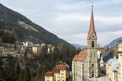 Preimskirche, Bad Gastein, Austria (violinconcertono3) Tags: travel autumn trees mountain mountains salzburg tower clock church nature water grass horizontal forest buildings river landscape religious outdoors austria europe village religion kirche steeple skiresort valley badgastein scenics placeofworship badhofgastein healthspa healthylifestyle hohetauernnationalpark europeanalps preimskirche wellnessresort