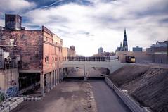 the.cut (jonathancastellino) Tags: city bridge sky usa cloud bird clouds mi construction path michigan detroit flight railway steeple redevelopment revisit dequindrecut