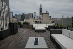 Aberdeen 11 (Chicago Roof Deck and Garden) Tags: aberdeen west loop roof deck chicagoroofdeck chicagodesign chicagogarden rooftopdesign roofdeckdesigners chicago garden birch poles ipe concrete firepit blue pebbles modern plantings outdoor furniture boxwood view skyline