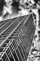 Up At the Building (pillarsoflight) Tags: city windows blackandwhite bw white black apple monochrome beauty clouds oregon contrast skyscraper reflections portland prime grey nikon apartments imac 28mm gray shades adobe pacificnorthwest pdx nik desaturated 28 stark visitor pnw sandisk lightroom crop apsc filmlens d3300 sensor shotonsandisk classicaperture