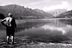 fishing (Lets go hand in hand.) Tags: fishing lake lakescape landscape blackandwhite bw daylight people fisherman man concentration italy italianlake view nature natural