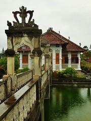 bridge to a palace (SM Tham) Tags: asia indonesia bali island karangasem amlapura tamanujong waterpalace watergardens gardenstosee bridge archway balustrades pond water reflections palace building outdoors