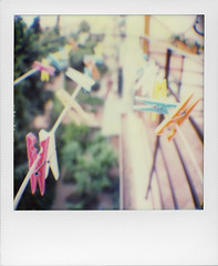 On a daily perspective (ale2000) Tags: polaroid film impossible sx70 analog analogue multicoloured hangers clothespins pins perspective fugue suspended hanged hanging instant framed frame