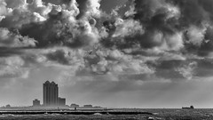 Approaching Galveston (Mabry Campbell) Tags: 200mm 2012 august galveston galvestoncounty gulfofmexico houstonphotographer mabrycampbell tx texas us usa unitedstates unitedstatesofamerica architecturalphotography architecturephotography blackandwhite boast building bw clouds coast coastal coastline colorimage commercialphotography dawn editorialphotography fineartphotographer fineartphotography image jetties jetty moody morning oiltanker ominous photo photograph photographer photography saltwater seascape ship shipping sky sunrise water waterscape waves f28 august172012 201208173690 ¹⁄₈₀₀₀sec 100 ef200mmf28liiusm fav10 fav20 fav30 fav40 fav50 fav60 fav70 fav80