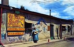 El Patio Grill Taos NM (Edge and corner wear) Tags: vintage postcard pc restaurant guitarist playing guitar woman street scene neon sign wall art mural land enchantment people nm new taos mexican cocktails food