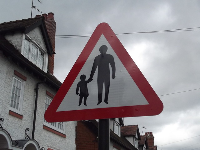 Hewell Road, Barnt Green - sign - adult walking a child