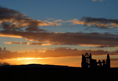 Setting Sun at Whitby Abbey (Tony Worrall) Tags: county uk sunset england sky color building beauty abbey season high nice ruins scenery stream colours tour open place yorkshire country hill north scenic visit scene location resort east holy whitby area outline northern update eastern iconic northyorkshire attraction settingsun whitbyabbey yorks englishheritage whitbyphotos yorkshirephotos welovethenorth ©2015tonyworrall photographsofwhitby