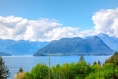 Across The Water (michaelnugent) Tags: ocean park blue trees portrait canada west green water vancouver clouds canon lens landscape eos bay scenery bc waterfront pacific northwest mark north columbia explore ii lions l 5d british 24 mm 105 pnw parc ef britannia