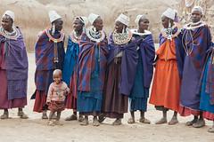 Maasai Women (Mathijs Buijs) Tags: africa blue canon tanzania eos beads sweater women toddler colorful village child traditional tribal dresses snoopy tribe masai maasai headdress krater ngorogoro 400d