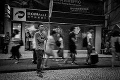The desire for desires (ivnseow) Tags: road street city people urban white man black monochrome standing walking nikon long exposure adult pavement bored wait macau handphone promoter d5500