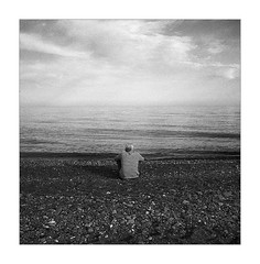 1274038808 (Yuriy Sanin) Tags:      2010 crimea ukraine blackandwhite yuriy sanin  oldman sea  pebble  issitting  sky 6x6  grainy  haze  alone  back  frock