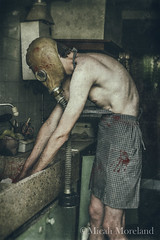 Washing the Dishes (micahmoreland) Tags: creepy horror surreal surrealism surrealist conceptual costume wheezer world war 2 ii dystopian scary haunting wet plate grunge texture male toxic death danger gas mask thin skinny abandoned house urbex urban exploration kitchen disturbing comical blood sink