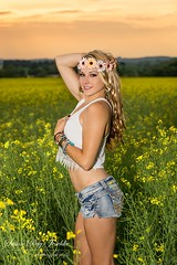 DSC_0400b wm web (Susan Day-Jeschke) Tags: flowers sunset portrait white girl beautiful field hat yellow pose hair golden model eyes cowboy pretty glow lace vibrant longhair posing crop blonde shorts blondehair cowboyhat modelling brilliant headband canola beautifulgirl daisydukes jewellry shortshorts canolafield croptop flowerheadband