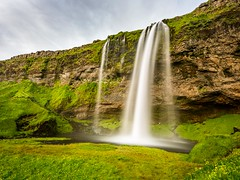 Seljalandsfoss Iceland (Einar Schioth) Tags: cliff cloud lake nature water grass clouds canon landscape photo waterfall iceland day outdoor ngc picture canyon grassland seljalandsfoss sland nationalgeographic einarschioth