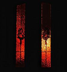 Pitchforks (SimApple) Tags: ifttt 500px no person dark shining glass gothic orange pitchforks torch streetlight flower speckled door