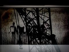 Dark Reflections (Steve Taylor (Photography)) Tags: hook ladder dark morbid art digital tag window black brown grey contrast stark scary eerie frightening spooky weird strange glass newzealand nz southisland canterbury christchurch cbd city distorted silhouette reflection texture construction crane