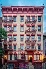 Jetlag (kaifr) Tags: morning fireescape overcast building yellow red newyork unitedstates us