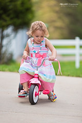 tricycle (Pollard Exposures Photography) Tags: girl photography kid toddler child tricycle biking tot pollard 2yearold exposures 135l