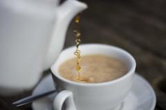 Pouring Tea (The6millionpman) Tags: cup 50mm nikon tea teapot liquid dripping pouring