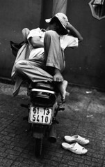 Moto Nap (H_H_Photography) Tags: nikonfe2 nikon film analog street streetphotography photography analogstreet blackandwhite bw candid beautiful moto motorbike vietnam travel seasia asia saigon hochimin city sleep sleeping reallife real kodak trix 400iso pushprocessing push