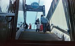 Castro Barros (Barcoborracho) Tags: subte subway buenosaires tnel salida cielo contraluz analgicos streetphotography f f17 grano kodakultramax400 lenteanalgico woman 35mm rangefinder telemtrica yashicaelectro35gsn ultramax azulcielo exterior claroscuro vintage