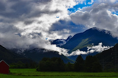 A coming storm (Roymond Olsen) Tags: elements norwegian norway highlands clouds mountains snowcapped powerlines barn farm norge roadtrip