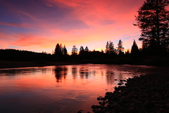 Swim with the current and float away (alideniese) Tags: grandtetonnationalpark wyoming usa river riverside riverbank water waterscape landscape sunset sundown dusk evening sky clouds silhouette trees pebbles stones reflection colour color