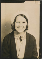 Smiling girl in the photo booth (simpleinsomnia) Tags: old woman white black girl monochrome hat smiling sepia vintage booth found happy photo blackwhite photobooth antique snapshot young photograph vernacular youngwoman foundphotograph