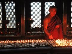 Kathmandu-Monk is lighting candles (Explored, 15/04/2015) (ustung) Tags: lighting nepal candles praying monks kathmandu