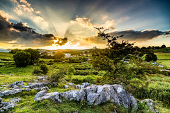 Sunset on Cunning Dale (MyWorldThroughMyLens) Tags: sunset england tree clouds bush rocks buxton unitedkingdom gb sunburst lowsun tonguelaneindustrialestate