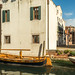 Colorful gondola moored on canal, Venice