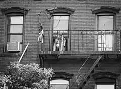 (Goggla) Tags: nyc new york east village bw fire escape cellphone tenement american flag fireescape