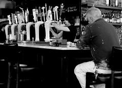 Feierabendbier. (Greyframe) Tags: feierabend feier abend beer bier greyframe schwarzweiss blackandwhite monochrome blackwhite white man bar pub kneipe paint painter painting ny new york grey bw blwh schwarz weiss schwarzweis draft waiter backshot back nyack