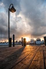 The Light Post (Isaac Guerrero) Tags: fellspoint lowperspective dock harbor sunset lightpost baltimore