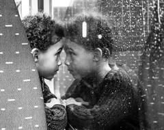 Child on the train to Brussels (voxpepoli) Tags: monochromatic child train reflection rain window drops children withe mirror mirroring black white blackwhite bw worldinbw