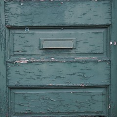 behind the green door (photography_isn't_terrorism) Tags: door green olympus faded cracked mailslot weatherd woodendoor epl5