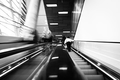 Blurred Lines (Number Johnny 5) Tags: street new york city nyc light bw reflection movement long exposure escalator d750 april tamron 2470mm 2015