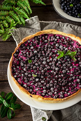 Homemade pie with bilberry  on dark wooden table (azimavu) Tags: pie tart rustic berrie cream brown purple view background summer healthy holiday fresh leaf food cake slice baked sweet pastry round fruit tasty sugar delicious table top gourmet wood home traditional wooden dessert bakery berry homemade crust bilberry craft paper blueberry dark