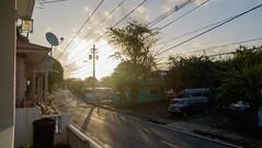 Fajardo sunrise (FlorianMilz) Tags: light sun house tree car bright puertorico first front porch pr rise fajardo