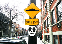 Death Ahead (Exile on Ontario St) Tags: montreal streetart graffiti plateau ruelle montral street art urbain urban wall murals mural walls painting plateaumontroyal alleys alley ruelles alleyway alleyways paint sign signe signes signs circulation trafic rue traffic head skull tte ttedemort death bump bumps yellow jaune panneaux signalisation routire panneau neige snow hiver winter pole telephone telephonepole poteau tlphone