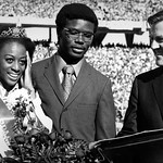 Homecoming Queen Mary Evelyn Porterfield with escort Michael Brown and Alumni Affairs director Bryce Younts; 1970