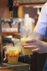 Flaming Moe (Read2me) Tags: she cye orlando drink beverage hands smoke yellow bar dof bokeh ge thechallengefactory pregamesweepwinner duele storybooksweepotr 15challengeswinner friendlychallenges